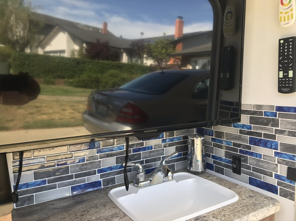 Put some stick on lightweight backsplash to the outdoor kitchen area. Colors match the side decals on the coach.